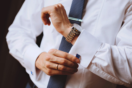 cuff: The man wears cufflinks on a white shirt. Mens watch Stock Photo