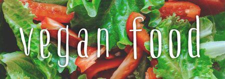 Vegan food - the inscription on the background of fresh vegetable salad. Background. Saver