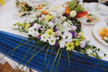 Wedding day. Flower arrangement on the table of the newlyweds