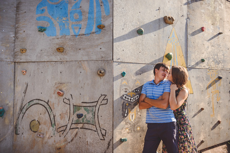 Couple men and women near the climbing wall Stock Photo