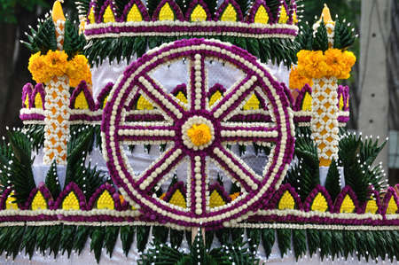 Wheel of Dhamma made from flower for Buddhist religious ceremony photo