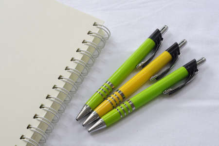 Notebook with pens on white background Stock Photo - 21197017
