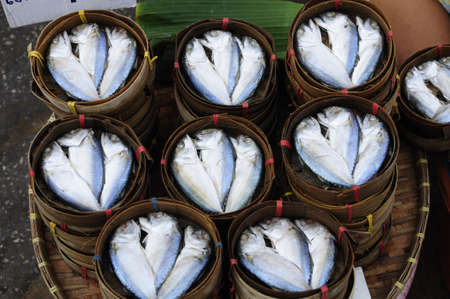 Steamed mackerels in bamboo basket photo