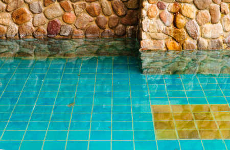 rockwall: Brick wall and reflection in water
