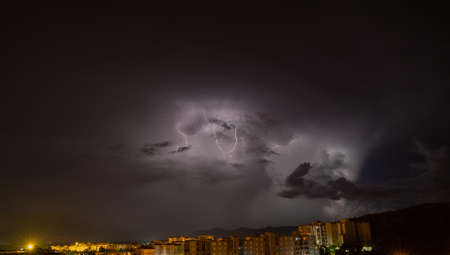 lightning and thunderstorm over the city of iglesias city in southern Sardinia Reklamní fotografie