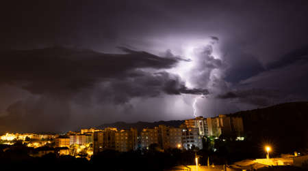 lightning and thunderstorm over the city of iglesias city in southern Sardinia
