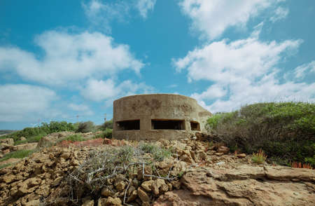 reinforced concrete bunker from the Second World War and located on the south-western coast of Sardinia
