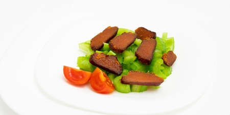 Plate of delicious bottarga with celery and cherry tomatoes, typical appetizer of Sardinia