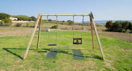 details of a children's swing in a playground