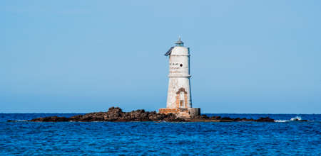 the lighthouse of the Mangiabarche on a serene autumn day Banco de Imagens