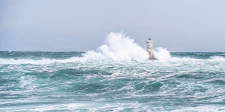 Big storm near a lighthouse, calasetta, south sardinia Banco de Imagens
