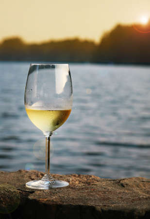 ocean view: A glass of chardonnay on a lake in Connecticut Stock Photo