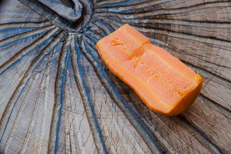 boiled carrots on a textured cutting Board Banco de Imagens - 72993654