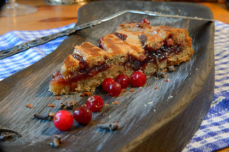 Cranberry pie on a textured cutting Board