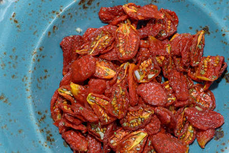 sun-dried tomatoes lined textured dishes Banco de Imagens - 87040318