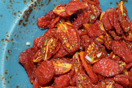 sun-dried tomatoes lined textured dishes Banco de Imagens - 87040319