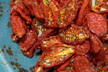 sun-dried tomatoes lined textured dishes