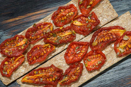sun-dried tomatoes on textured Board Banco de Imagens - 87040322