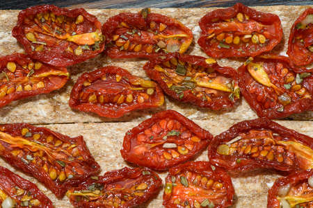 sun-dried tomatoes on textured Board