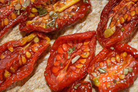 sun-dried tomatoes on textured Board Banco de Imagens - 86961816