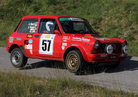 pilotage: A 112 Abarth rally car on two wheels