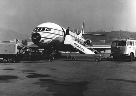 70 80: airplane makes a stop at the airport Cristoforo Colombo in Genoa (70 -80)