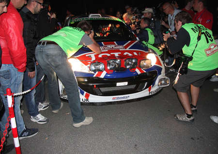 sanremo: Photographers and videographers around the car That has just a test of speed of the Sanremo Rally 2013 Editorial