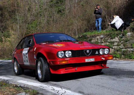 Sanremo Rally - April 14 2018 - Testico Italy: Alfa Romeo Alfetta GTV racing car engaged during the race on the heights of Imperia. Editorial