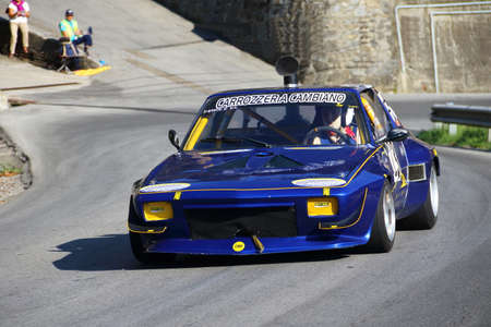 Fiat x 19 racing cars - Rising speed race Chiavari Leivi - Chiavari (Italy) 093009. Reading engaged during the race. Editorial