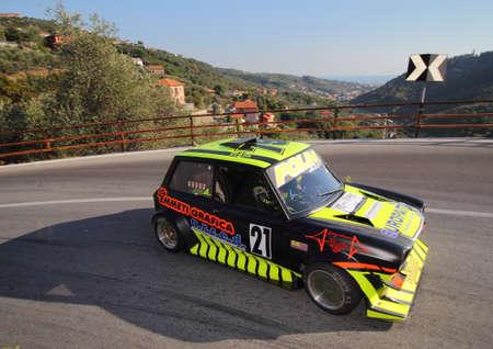 A 112 Bmw racing cars - Rising speed race Chiavari Leivi - Chiavari (Italy) 093009. Reading engaged during the race.