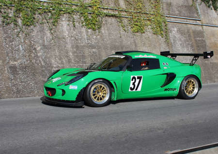 Lotus Exige racing cars - Rising speed race Chiavari Leivi - Chiavari (Italy) 093009. Reading engaged during the race.