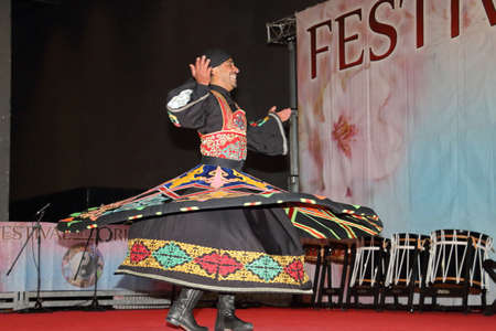 .Genoa -Italy March 8, 2019: Egyptian dance Tannura of rotating dervishes the festival of the east of Genoa. It is a whirling rotation that shows off the wide skirt of the dancers: the Tannura.