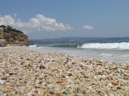 waves and beautiful coloured pebble on Tripiti beach, Thassos, Greece photo