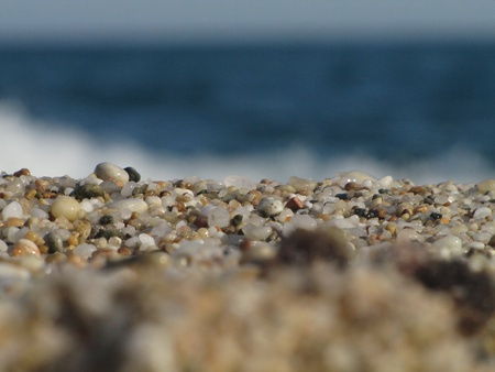 close up view on lovely particoloured pebble on Tripiti beach, Thassos, Greece photo