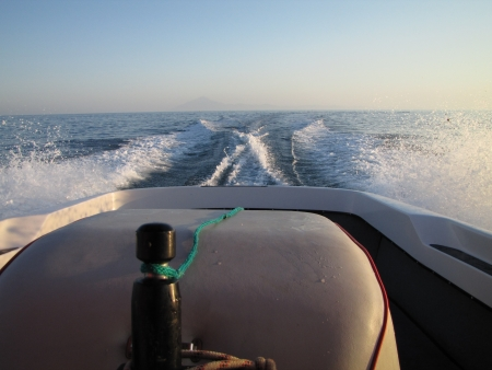 Morning boat drive, blue sea and Mt Atos, Thassos, Greece  photo