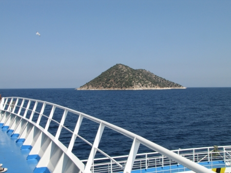 Small island on ferry trip from Keramoti to Limenas, Thassos, Greece photo