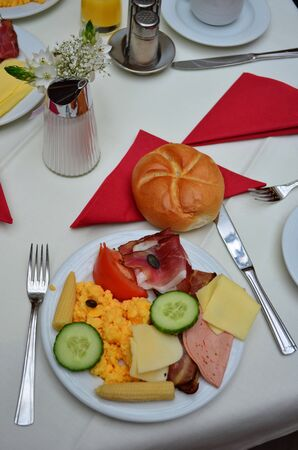 Copious breakfast, served on a table in a hotel, Vienna, Austria photo