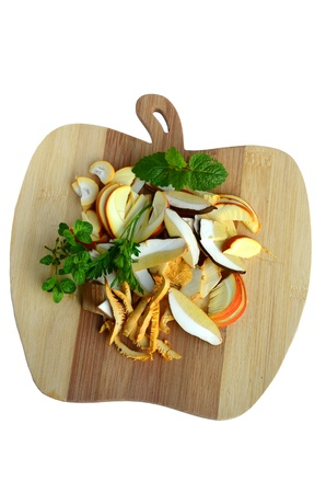 Mushroom soup ingredients, delicious forest mushrooms - Caesars Mushroom, Chanterelle and Porcini, sliced on the wooden chopping board together with fresh, green spices photo