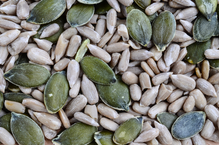Healthy background - macro shot of shelled pumpkin and sunflower seeds photo