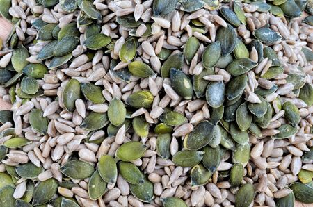 Healthy background - full frame of shelled pumpkin and sunflower seeds photo
