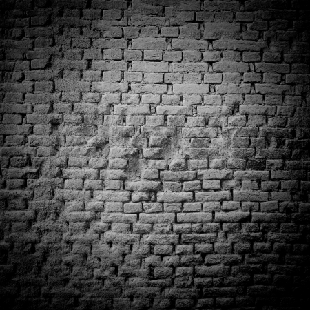 Not calcined brick wall grunge , with a large surface area for text, black white, with vignette photo