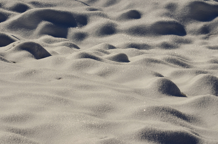 drifts: Mountain meadow covered by fresh snow drifts