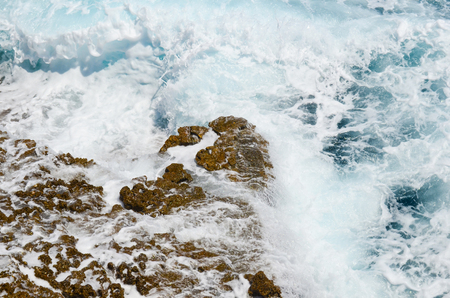White and blue meerschaum around solid rock photo