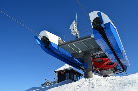Last stop of ski lift with small cottage and frozen antenna in background, ski resort Kopaonik, Serbia