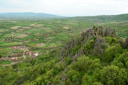 fertile: Ancient volcanic rocks that rise high out of fertile plains, Borac village, Serbia