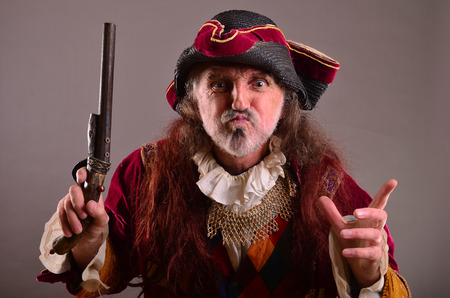 requires: Old pirate is angry, requires attention by face expression and hand speech,  waving by the gun