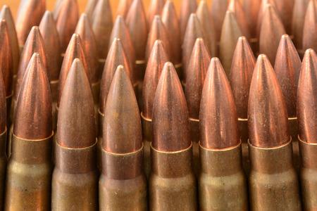 ak47: Lot of AK-47 Kalsnjikov rifle 7.62x39 caliber bullets in a row, close up view Stock Photo