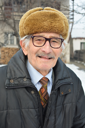grizzle: Portrait of vital elderly man in a good mood, posing and smiling