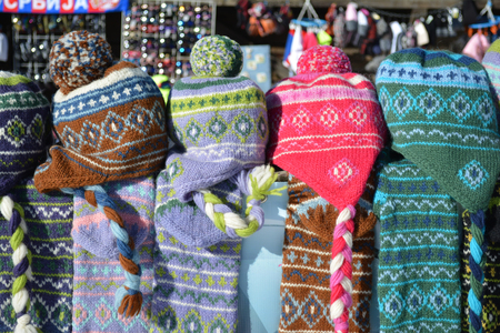 bobble: Pile of colorful woolen caps with tassel on a souvenir stand Stock Photo