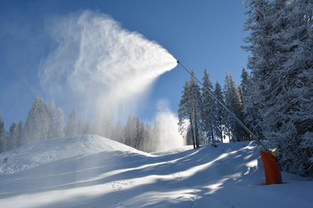 snow grooming machine: Snow machine in action, artifical snow making, ski resort Kopaonik, Serbia Stock Photo